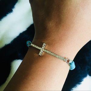 NWOT turquoise cross bracelet with rhinestones OS